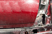 istock Broken rear stop light and bumper in crash accident on damaged red car with dented sheet after break check on the highway selective focus 1151556679