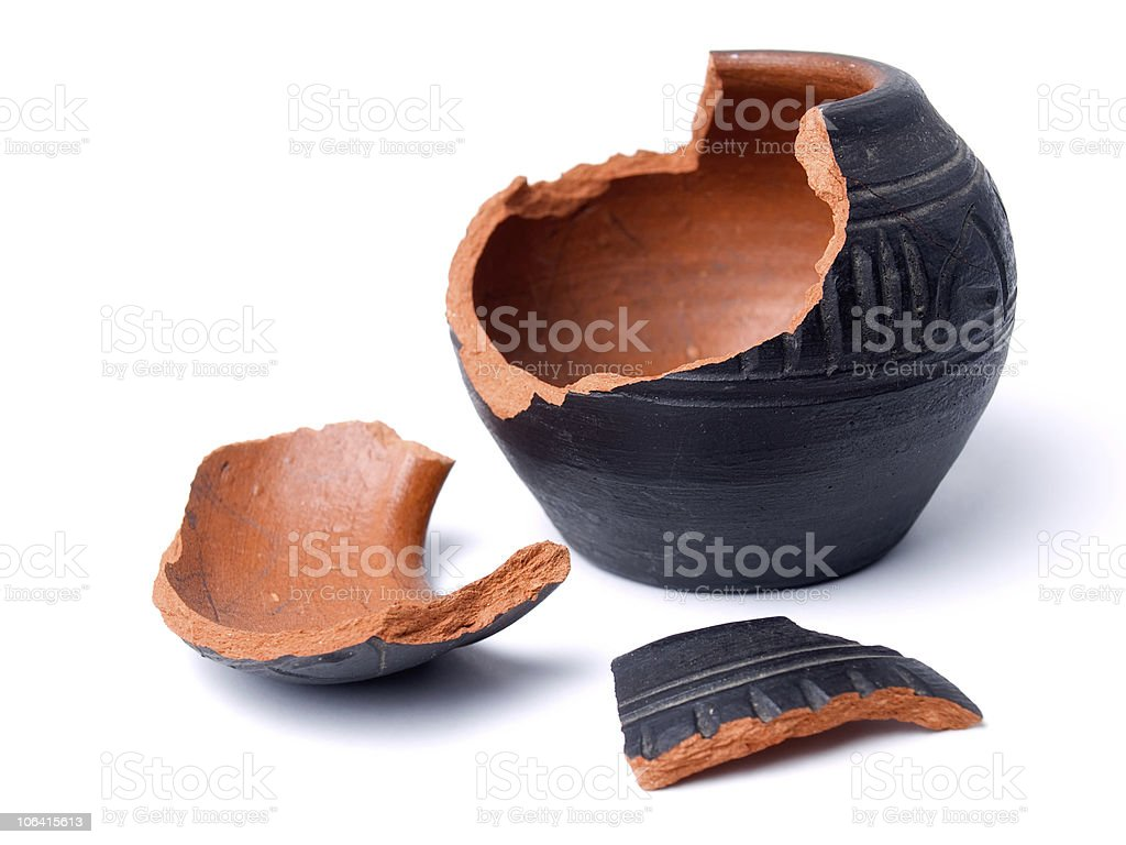 A broken red clay pot isolated on a white background stock photo