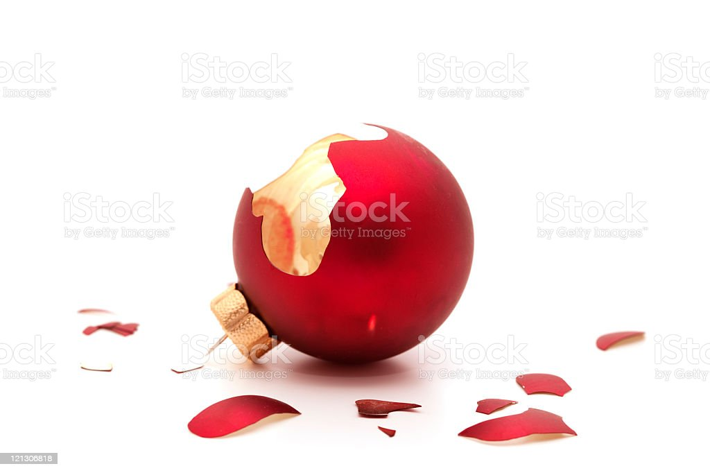 Broken red ornament on a white background stock photo