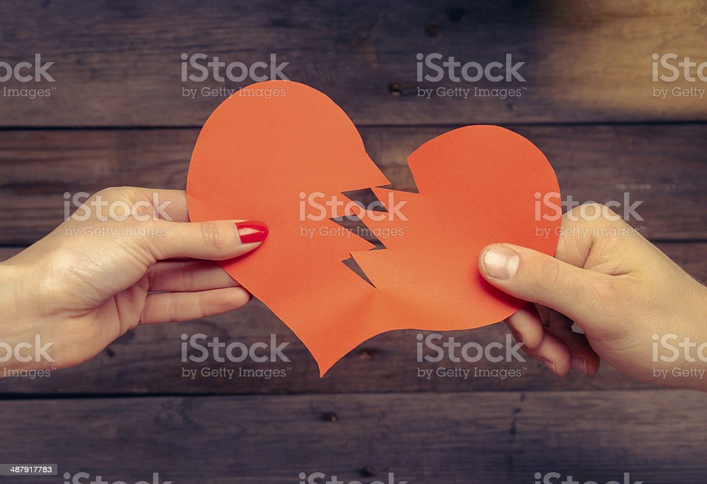 Broken red paper heart stock photo