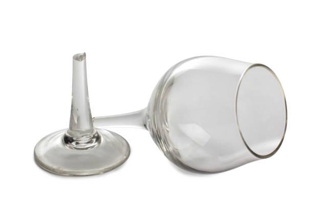 Broken red wine glass stock photo