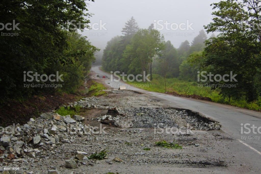 Broken road, bad asphalt stock photo