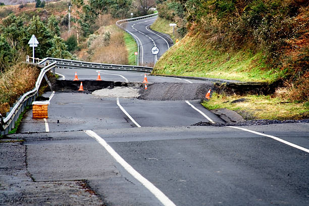 broken road - natural disaster stock pictures, royalty-free photos & images