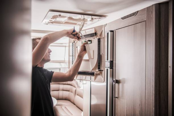 Broken RV Air Condition Broken RV Air Condition Unit Repair by Professional Technician. Travel Trailer Appliances. Travel Industry Theme. rv interior stock pictures, royalty-free photos & images
