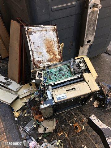 istock Broken scanner thrown in the street 1128949527