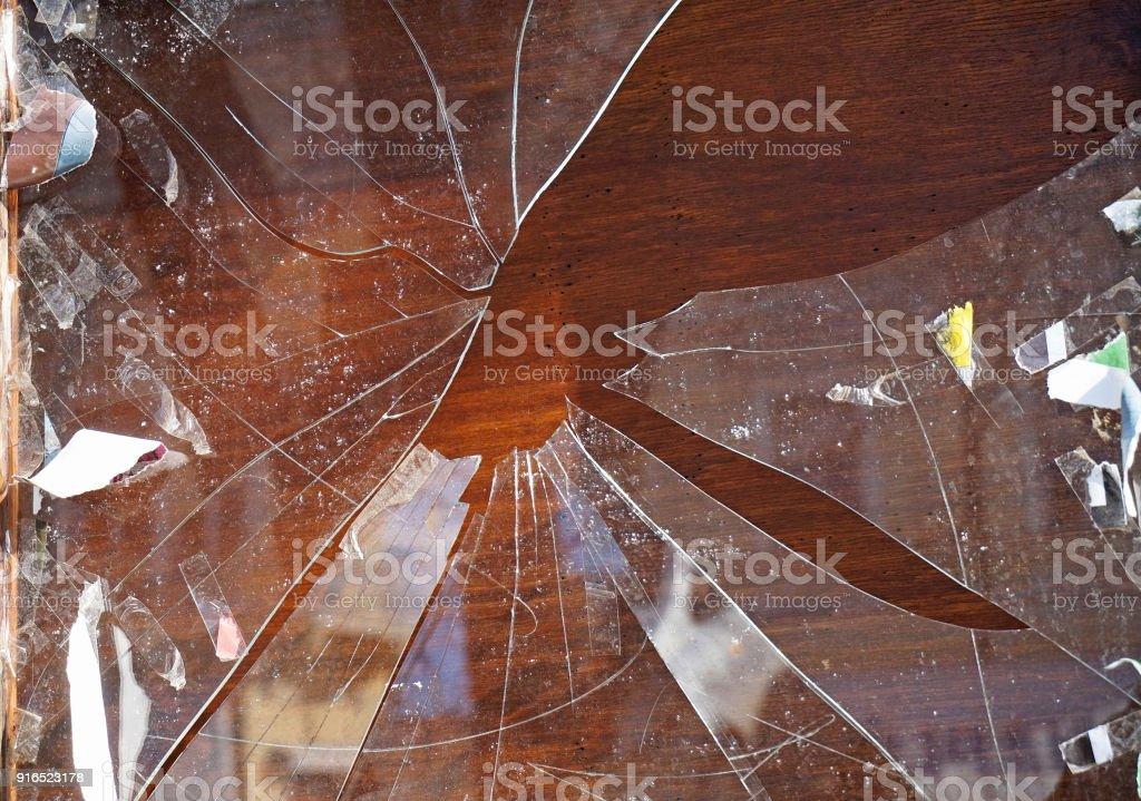 Broken shopwindow closeup in summer stock photo