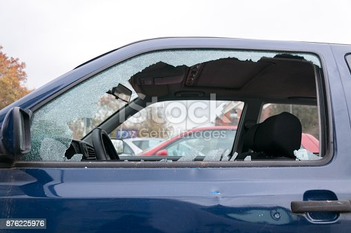 istock Broken side window glass on the damaged car door 876225976