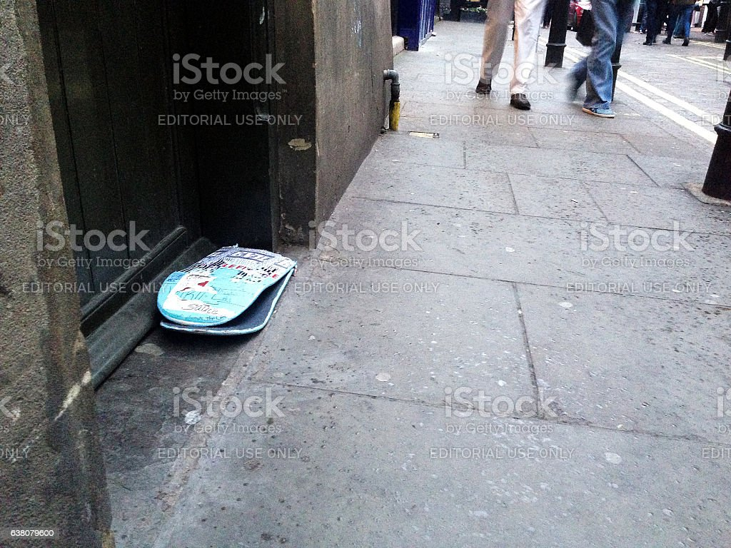 Broken skateboard, discarded in the street stock photo