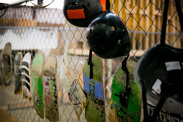 Broken Skateboard Displayed on a Chain Link Fence Decor stock photo