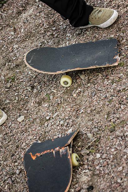 Broken skateboard stock photo