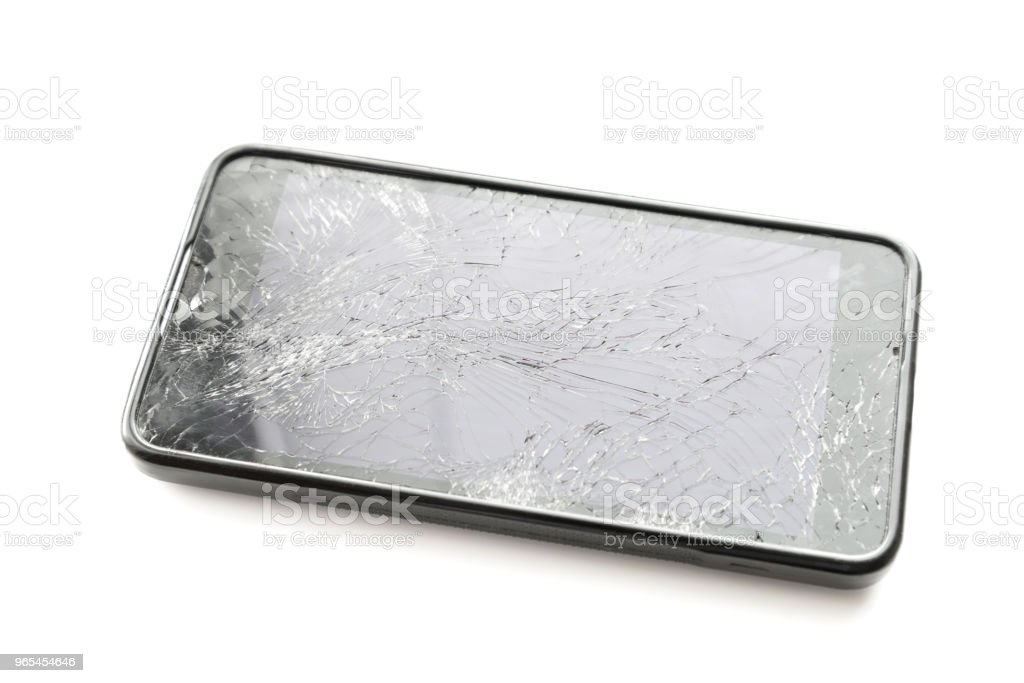 Broken smartphone screen on white. royalty-free stock photo