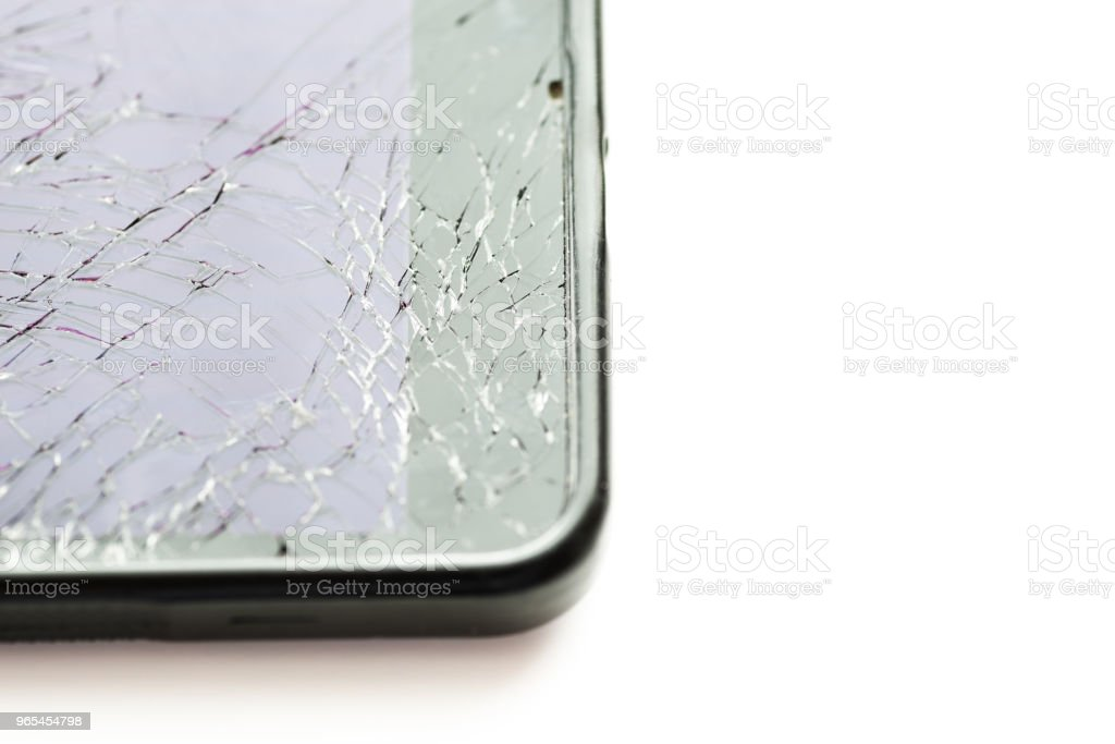Broken smartphone screen on white. zbiór zdjęć royalty-free