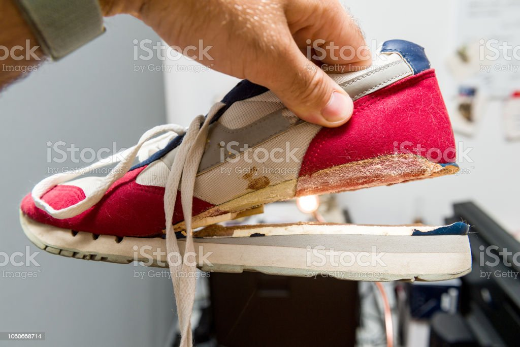 Broken sole on sport daily shoes wear side view stock photo