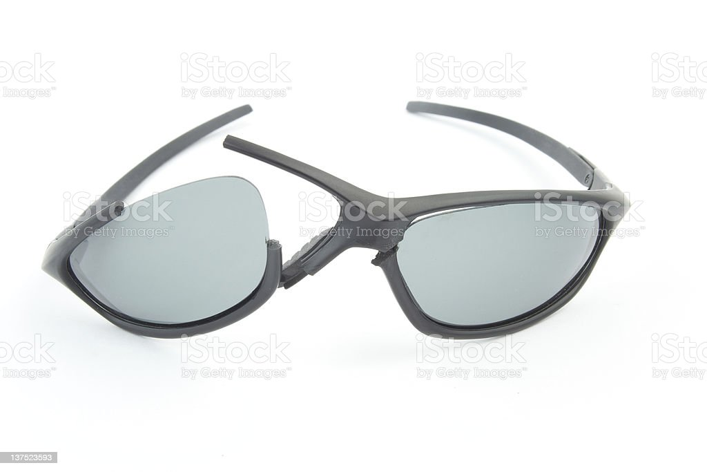 Broken sport stlye sunglasses stock photo