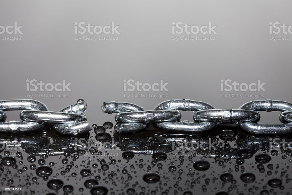 Broken steel chain stock photo