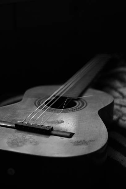 broken string guitar - broken guitar stock photos and pictures