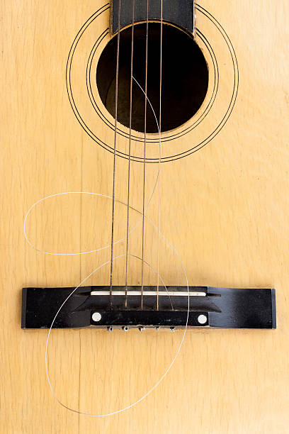 broken string - broken guitar stock photos and pictures