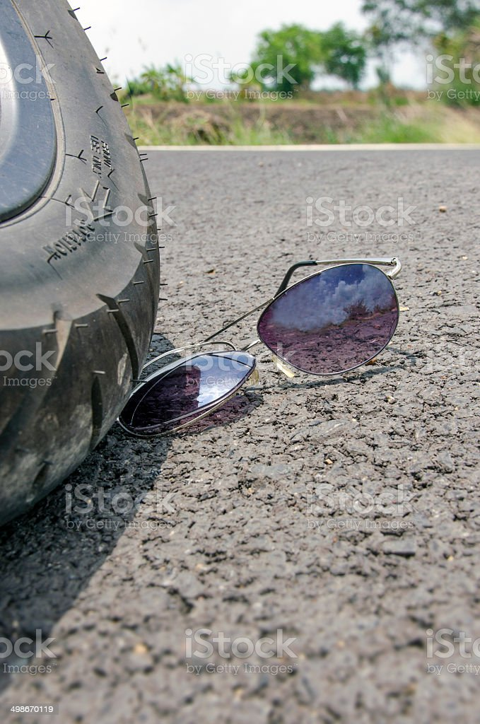 Broken sun glass stock photo