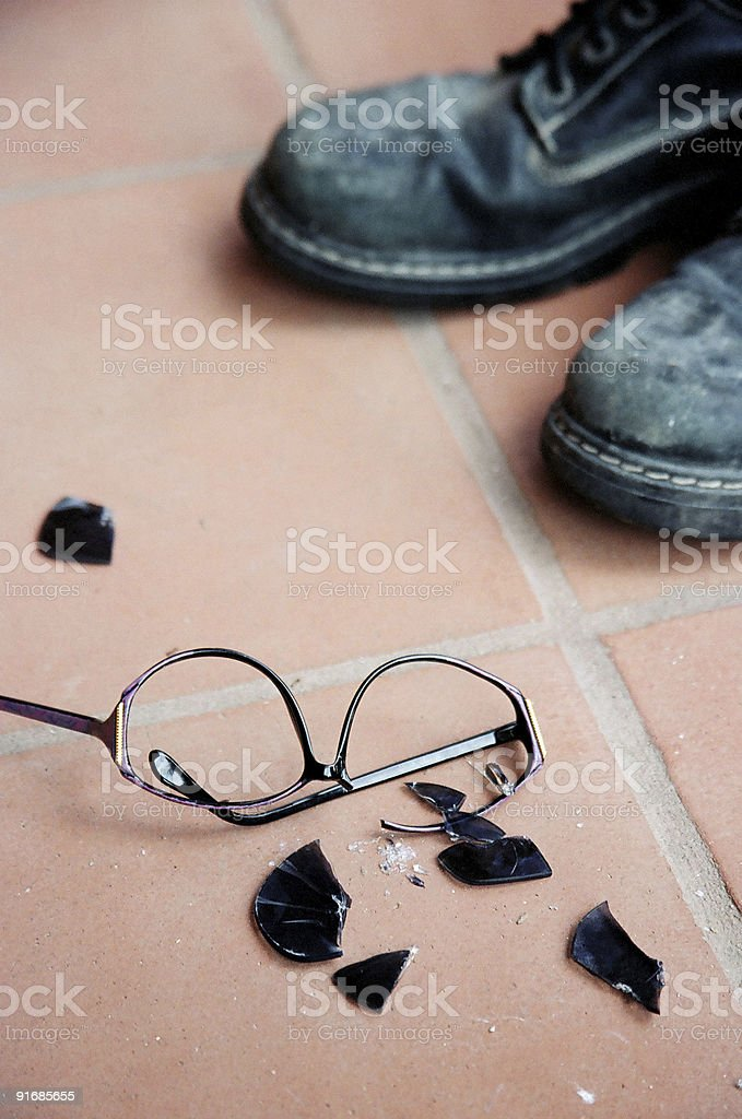 Broken Sunglasses and Black Boots stock photo