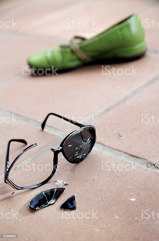 Broken Sunglasses and Green Shoe stock photo