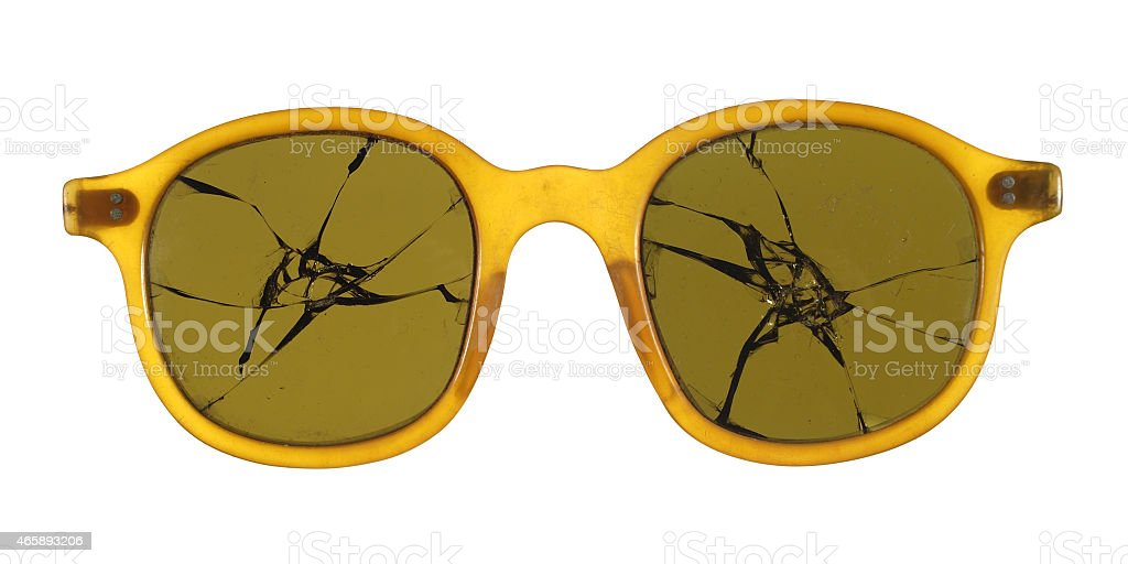 Broken sunglasses fashioned from plastic isolated on white background. stock photo