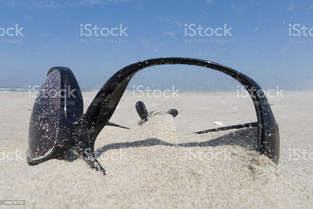 broken sunglasses in sand royalty-free stock photo