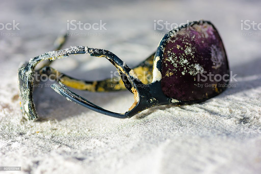 Broken Sunglasses on beach stock photo