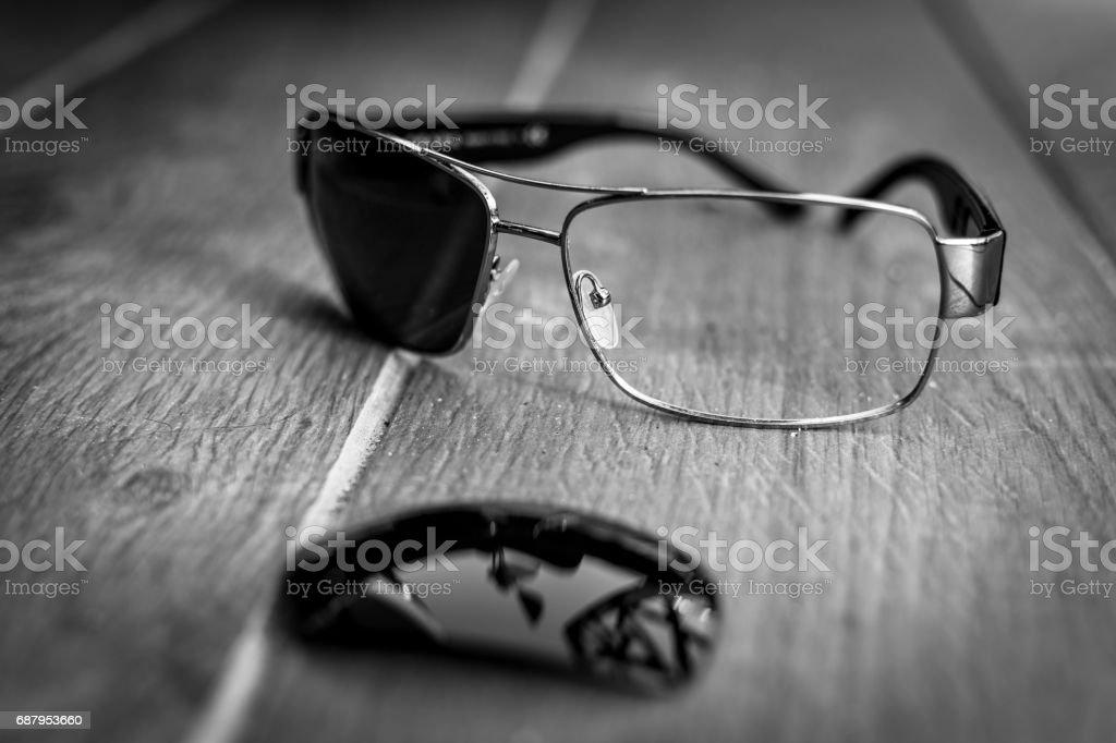 Broken Sunglasses on the Floor as Fine Art stock photo