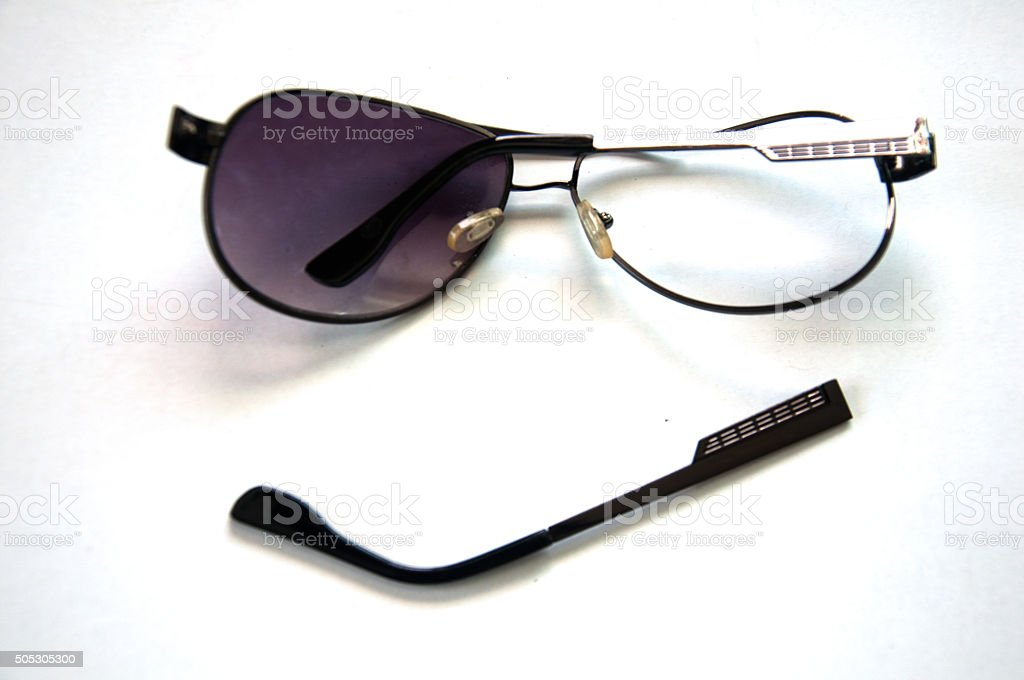 Broken sunglasses on white background stock photo
