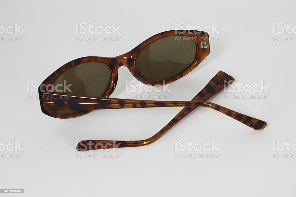 Broken sunglasses  with frame apart - isolated stock photo