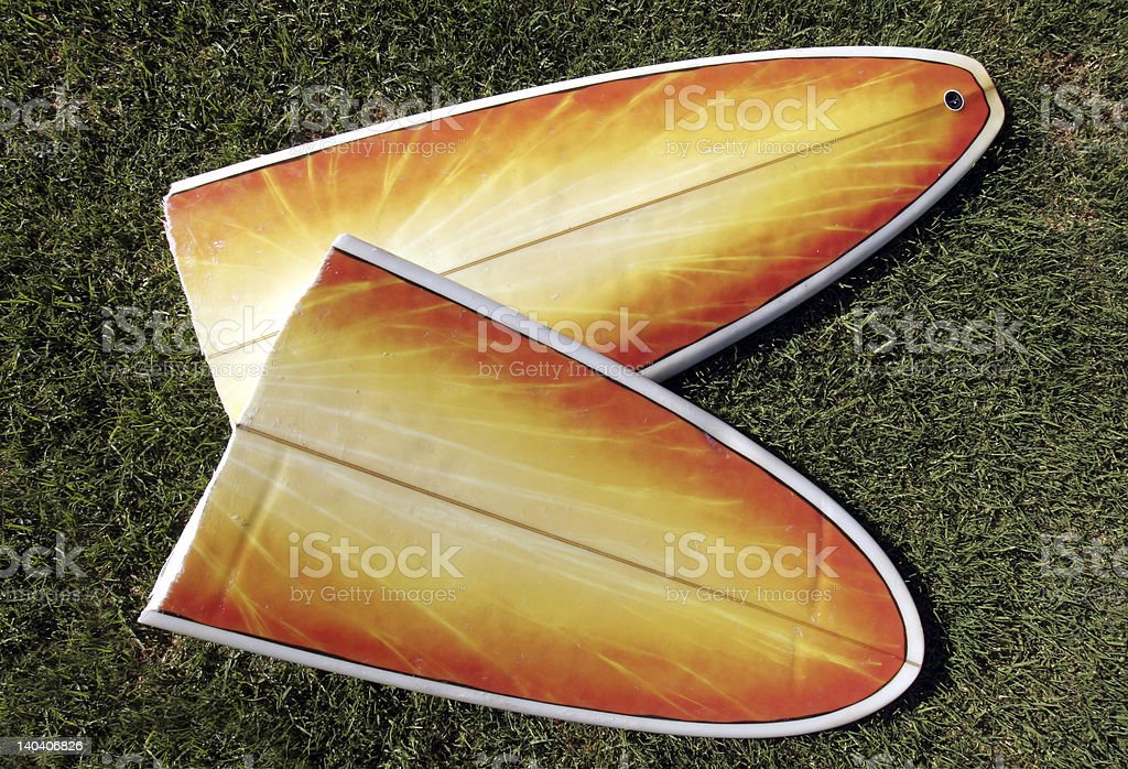 Broken Surfboard stock photo