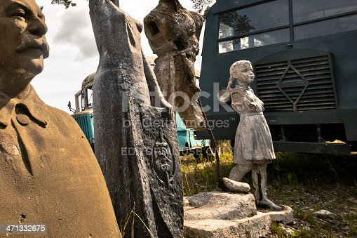Talicy, Russia - August 27, 2011: Symbols of Stalin Epoch in the Historic Museum. Broken sculptures in park