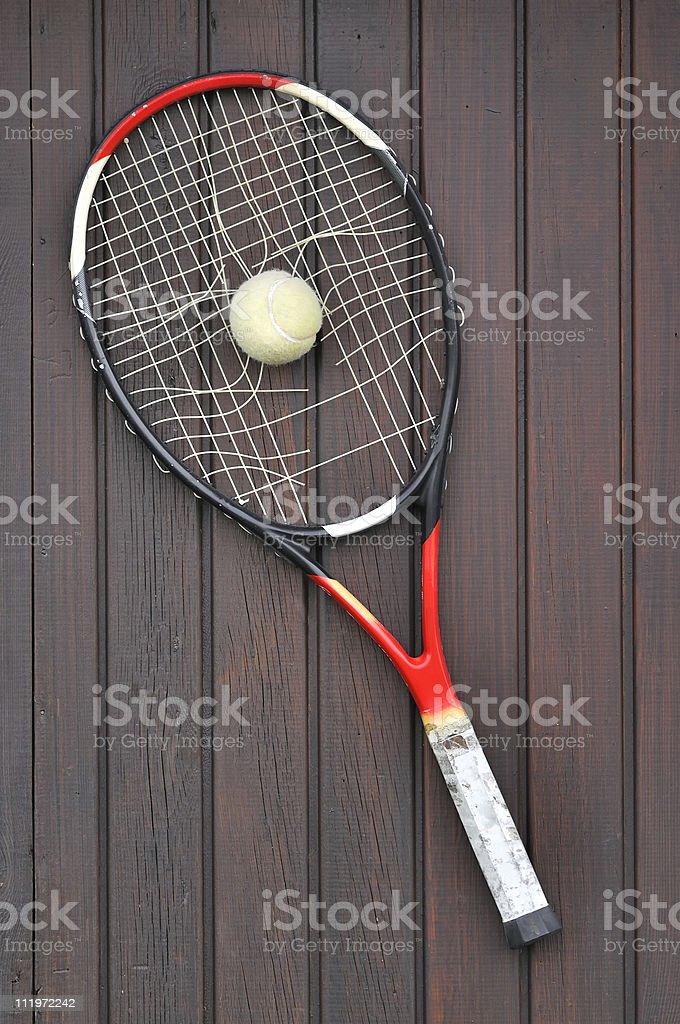 Broken Tennis Racket and Ball stock photo