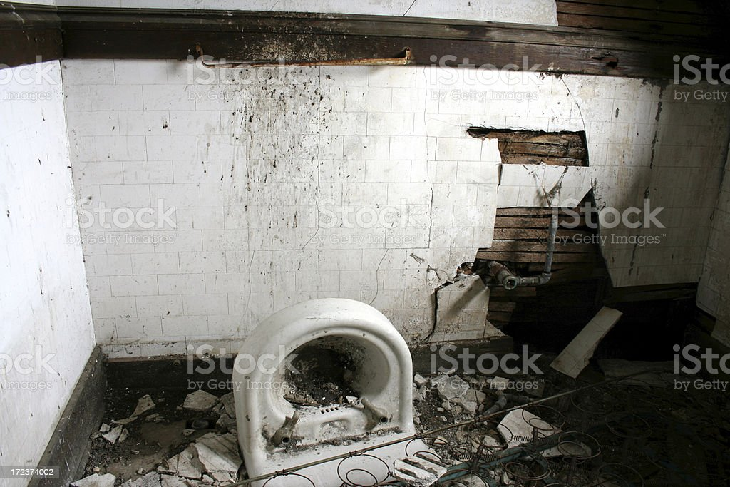 Broken tile, destroyed sink in abandoned home bathroom royalty-free stock photo