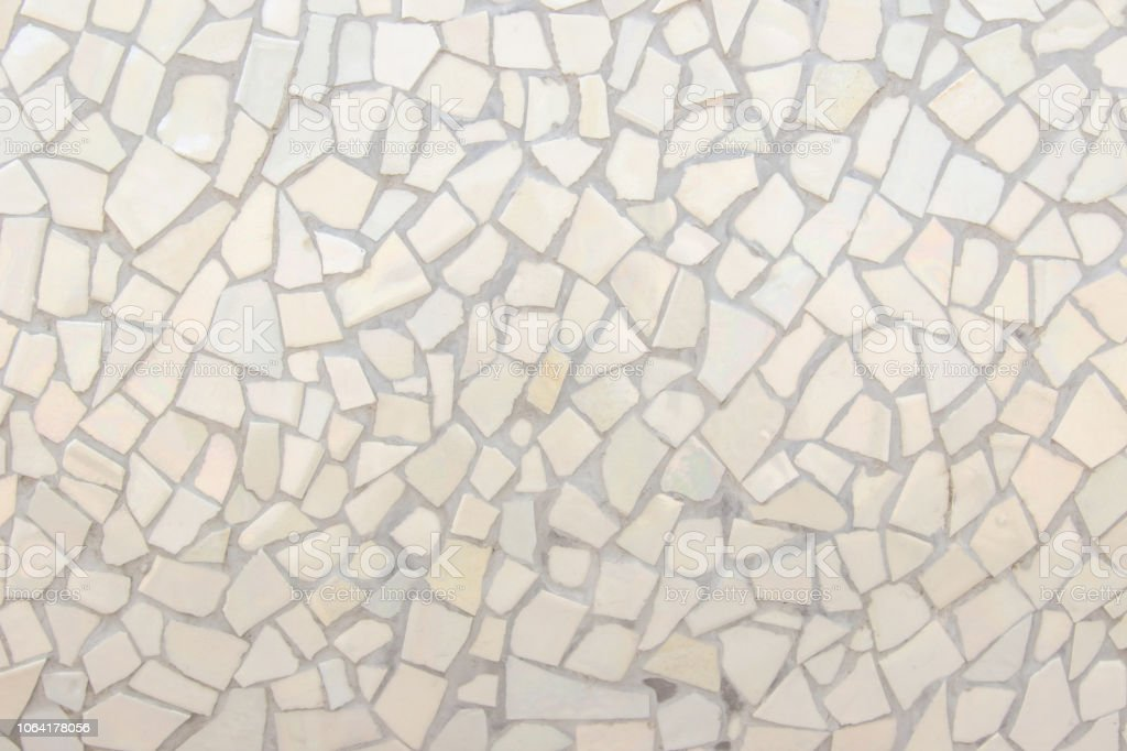 Broken tiles mosaic seamless pattern. Cream and Brown the tile wall high resolution real photo or brick seamless and texture interior background. stock photo