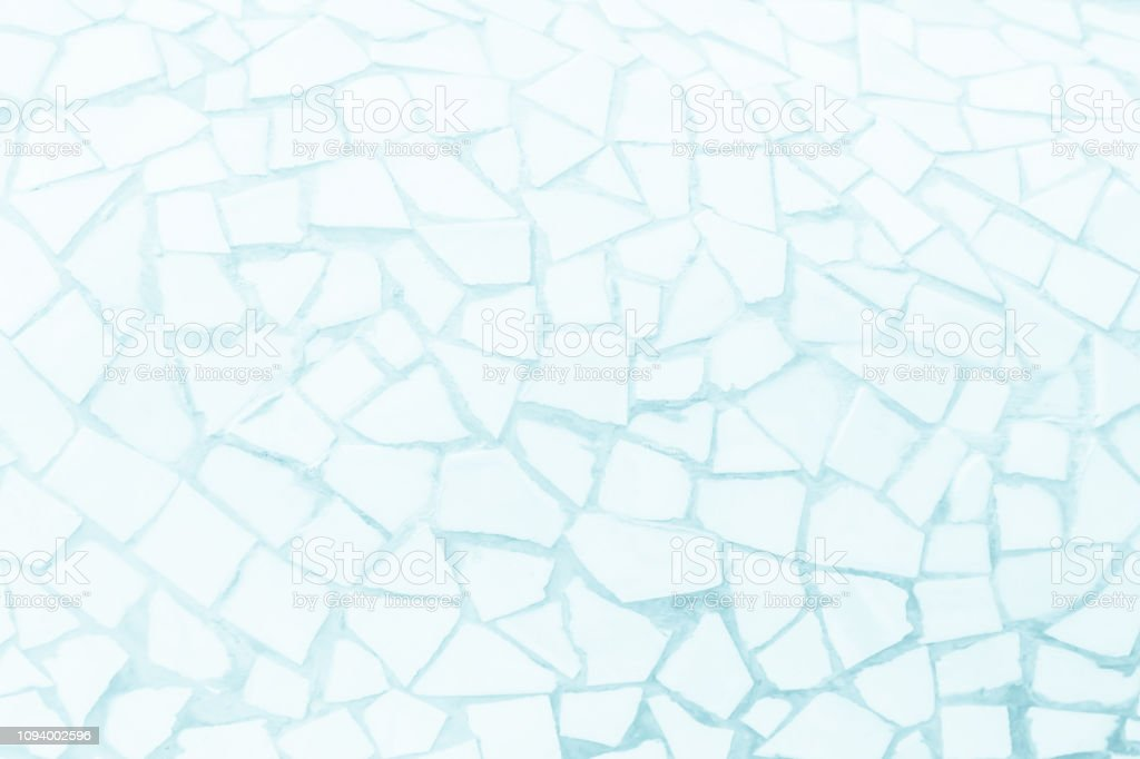 Broken tiles mosaic seamless pattern. Pastel Blue tile wall high resolution real photo or brick seamless and texture interior background. stock photo