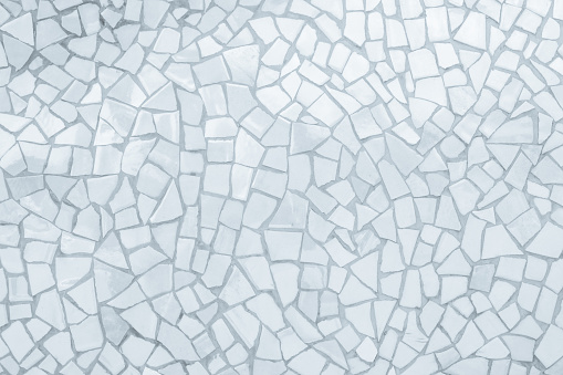 istock Broken tiles mosaic seamless pattern. White and Grey the tile wall high resolution real photo or brick seamless and texture interior background. 1058785836