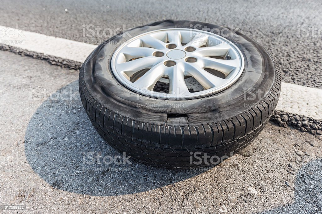 Broken tire damaged on surface putting on edge of road stock photo