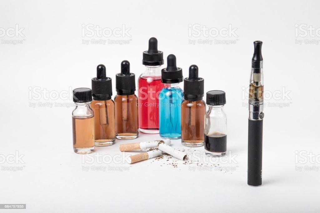 Broken tobacco cigarettes with modern electronic cigarette stock photo