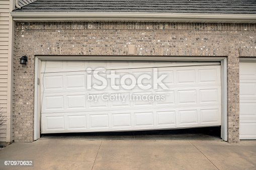 istock Broken Two Car Residential Garage Door 670970632