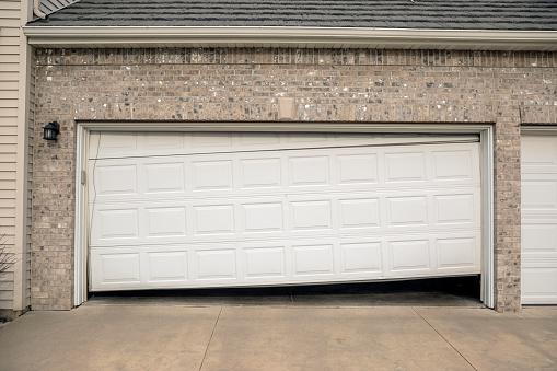 A garage door is damaged or broken.