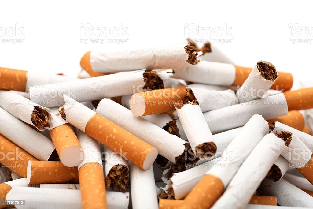 Broken up cigarettes all piled together royalty-free stock photo