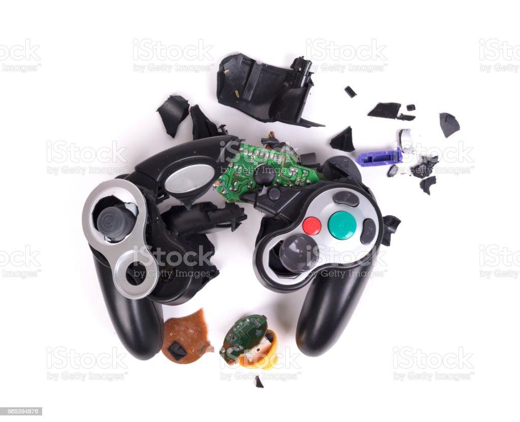 Broken video game controller on white background zbiór zdjęć royalty-free