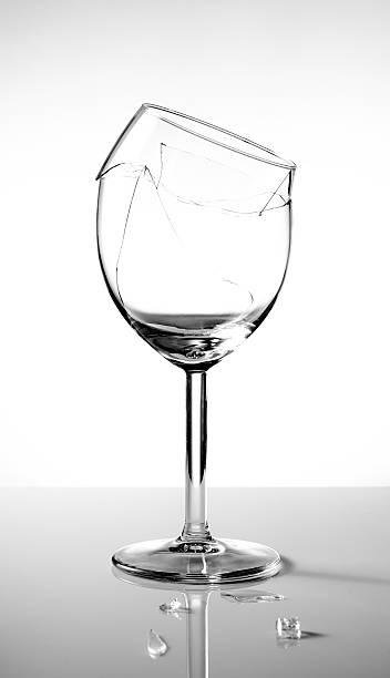 Broken vine glass stock photo