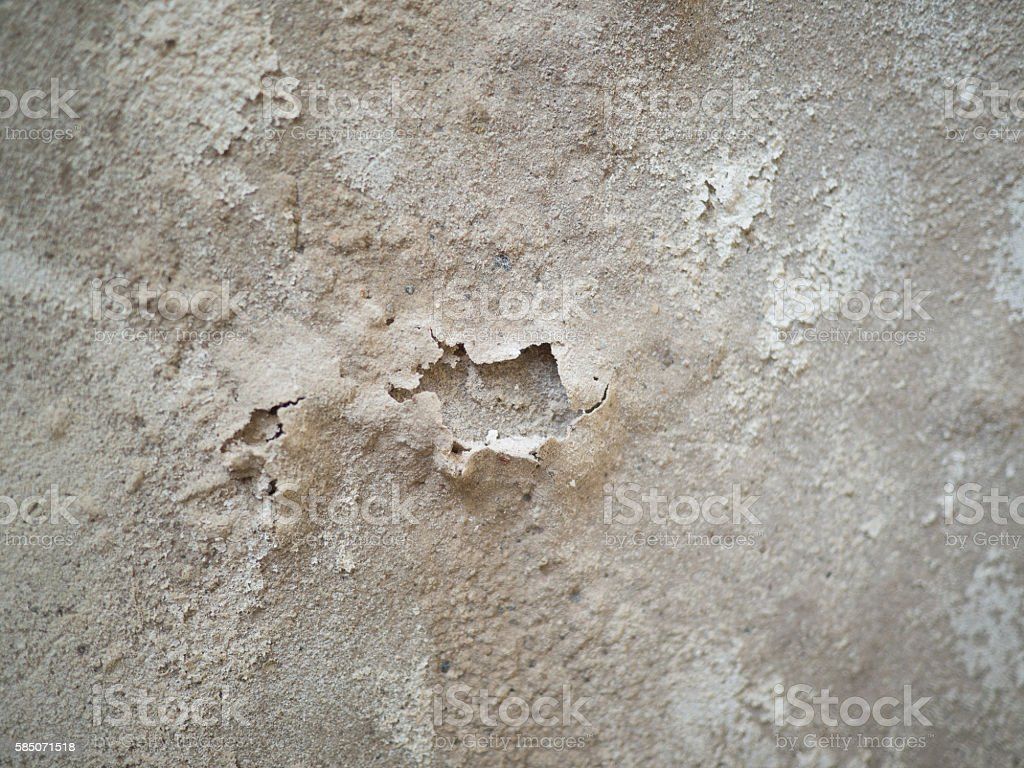 Damaged broken cement plaster with holes