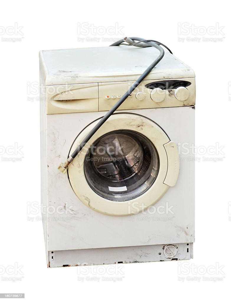 A broken washing machine unplugged stock photo