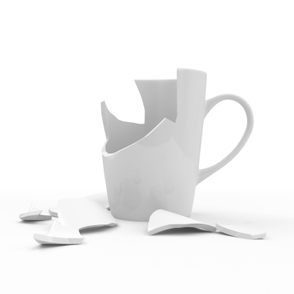 istock Broken White Cup isolated on white background 497995573