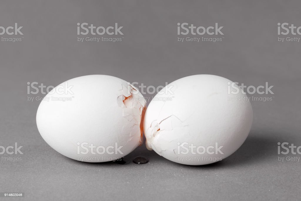 Broken white give eggs with a crack through which you can see the...