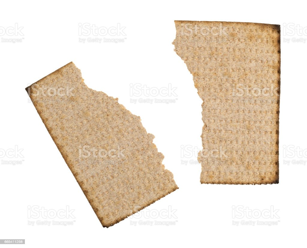 Broken whole wheat matzo cracker on a white background stock photo
