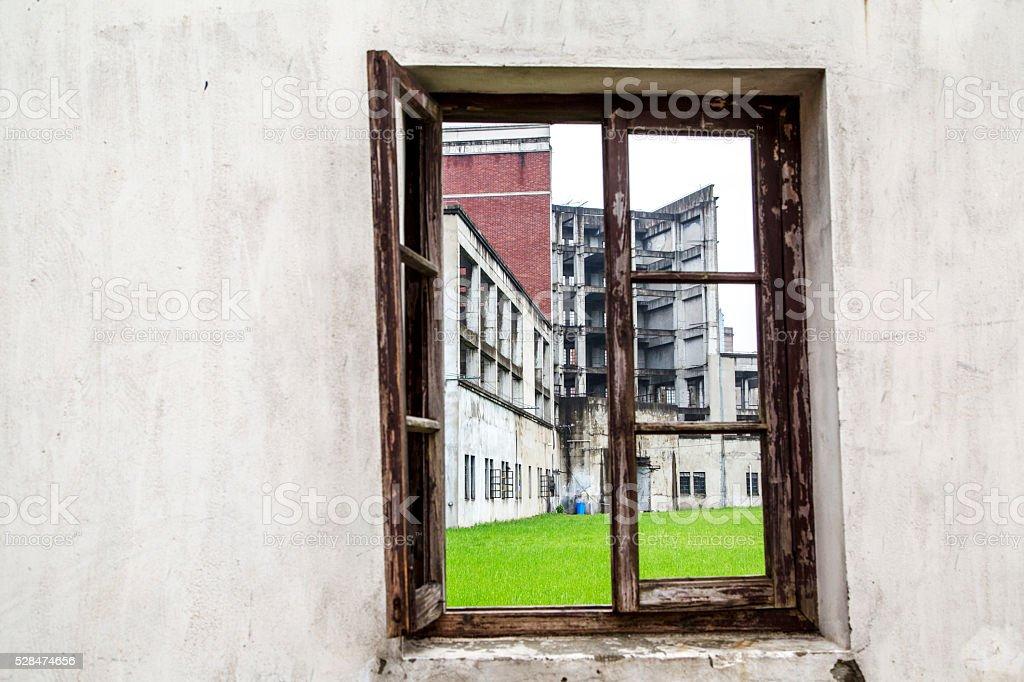 broken window and building ruins stock photo